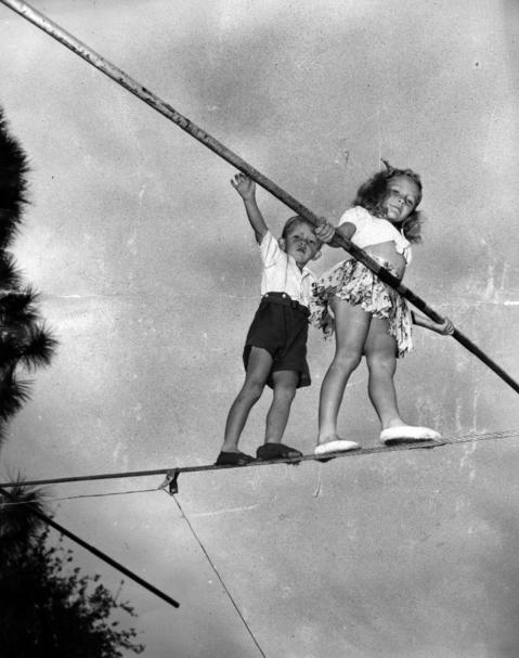 Carla Wallenda, 9, and her younger brother Mario, 4, walk the high-wire at the circus' winter training quarters in Sarasota, Florida, in March 1945. The children were there with their parents, members of the high-wire performing Wallenda Troupe. Seventeen years later, Mario would fall from the high-wire, leaving him paralyzed.