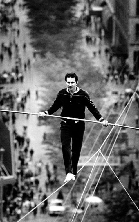 High above the 16th Street Mall in Denver, Co., Tino Wallenda, of the famous Flying Wallenda family, walks the high wire on May 23, 1987.