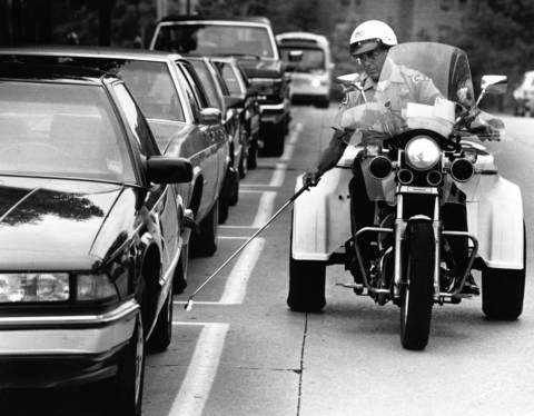 July 19, 1989: Officer Hank Schotanus marks tires in a timed parking zone on July 19, 1989.