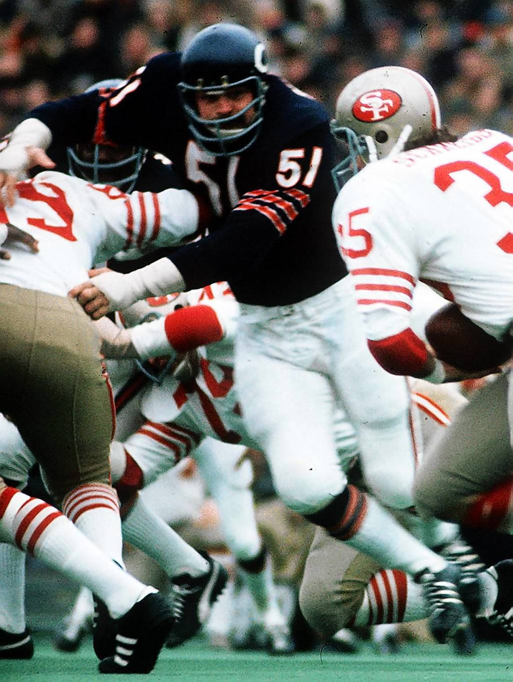 Dick Butkus rushes through the line of scrimmage against the 49ers during a game on Nov. 19, 1972.