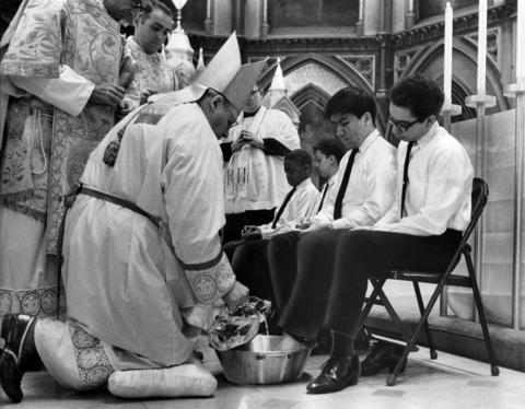 Cardinal John Cody prepares to wash the feet of one of 12 youths in a ceremony during Holy Week on April 11, 1968, at Holy Name Cathedral in Chicago.
