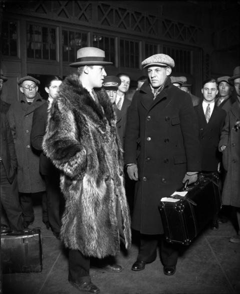 "Harold ""Red"" Grange, right, who is returning from a coast to coast ""football tour"", is greeted by his brother Garland Grange, left, upon his arrival at the Chicago and Northwestern rail station on Feb. 4, 1926."