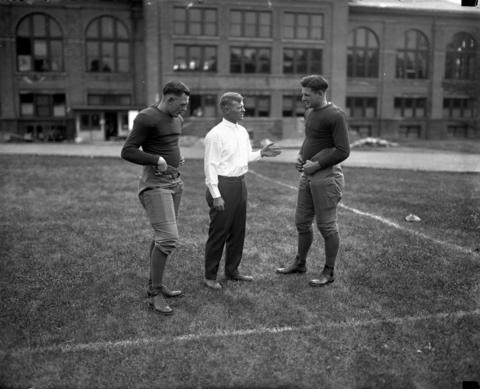 "A meeting of the Illini board of strategy: Harold ""Red"" Grange, from left, Coach Robert Zuppke, and Earl Britton at the University of Illinois in 1924."