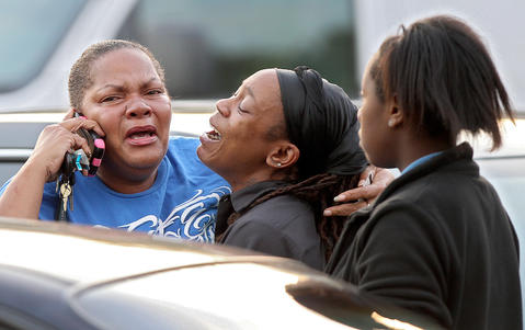 Staff Photo Of The Week: Sept 27-Oct 3, 2014     Friends and family of stabbing victim Taiwo Douglas-Wells react Wednesday evening in the parking lot of Newsome Park Elementary School.