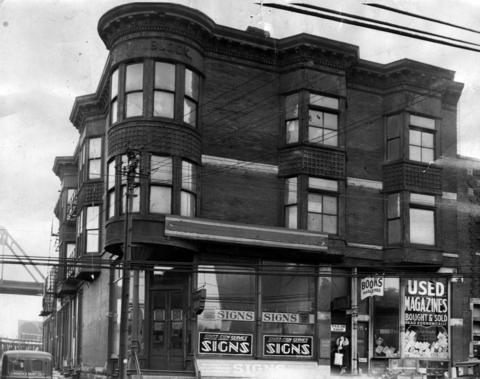 """The H.H. Holmes """"murder castle"""" in March 1937. The building at 601-603 West 63rd Street was sold in 1938 and was razed to make way for an Englewood post office. The main entrance is at 603 E. 63rd Street and housed a sign company in 1937 where Holmes had his drug store."""