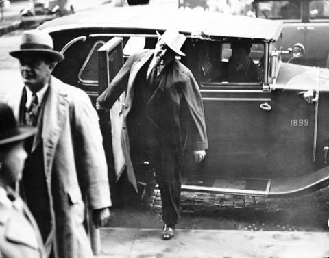 Al Capone, with cigar, and his attorney Michael Ahern arrive at the Chicago Federal Building for Capone's tax evasion trial in October of 1931.