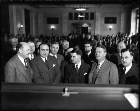 Al Capone, second from left, in Chicago's criminal courthouse in 1931.