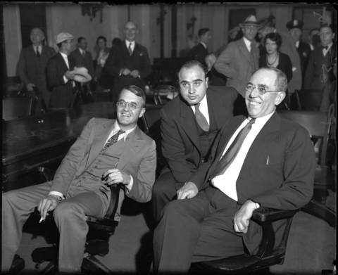 Al Capone, center, in federal court in Chicago during his 1931 tax-evasion trial, with lawyers Michael Ahern, left, and Albert Fink.