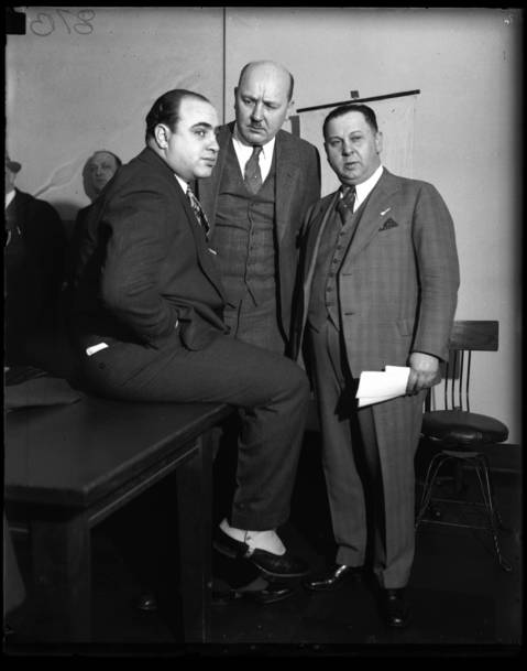 Al Capone, left, Asst. State Attorney Frank Mast and Bailiff Joe Weinberg in a Chicago Federal Building courtroom in 1931.