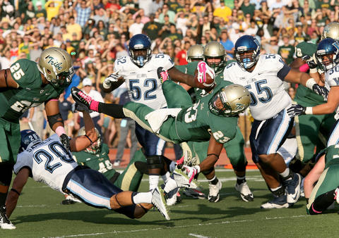 Staff Photo Of The Week: Oct 18-Oct 24, 2014     William & Mary's Kendell Anderson dives into the endzone over Villanova's Joe Sarnese during the second quarter Saturday in Williamsburg.