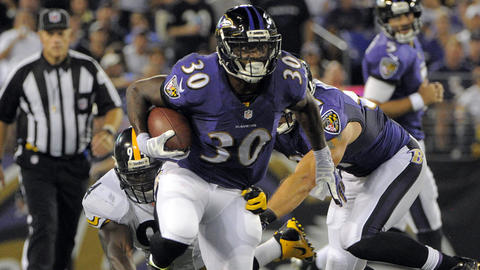 Ravens running back Bernard Pierce runs up the middle against the Pittsburgh Steelers at M&T Bank Stadium.