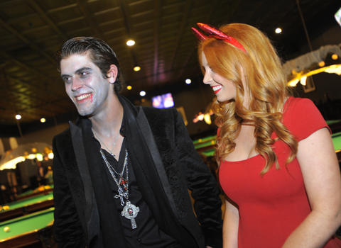 Ravens kicker Justin Tucker with Amanda Bass at the 14th Annual Goodwill Gridiron Halloween Party.