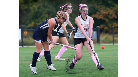 Mauri Ware, left, HRA, and Bridget Killilea, Walsingham, vie for the ball, with Rachel Clancey moving in. Hampton Roads Academy at Walsingham Academy field hockey. Walsingham won 3-0.