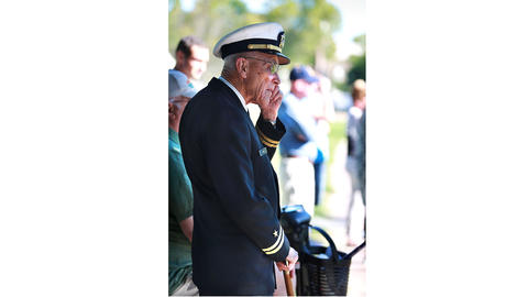Ed Oyer shows his respect by wearing his lieutenant uniform he wore in the navy; while he served from 1952-1973, he was off shore. Oyer attended the opening ceremonies of the Wall That Heal, a traveling replica of the Vietnam Memorial.
