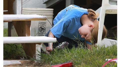 At the Dreamcatchers horse stables, Adia Blanchard, helps paint steps; she tagged along with the Historic Triangle Rotary Club.