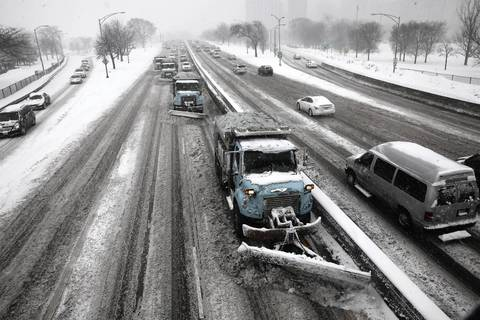 Looking south on Lake Shore Drive at northbound traffic from the North Avenue overpass bridge. Blizzard conditions hampered rush hour traffic on Lake Shore Drive where snow plows had difficulty keeping up with the snowfall.