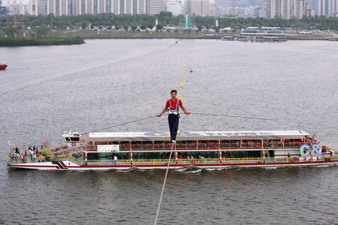 Alessandro Henry Wallenda-Zoppe participates in the 2009 World High Wire Championships over the Han Gang River in Seoul, South Korea.