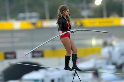 Lijana Wallenda walks the tightrope above Charlotte Motor Speedway with her brother, Nik, 140 feet above pit road during the pre-race show at the Bank of America 500 NASCAR Sprint Cup race in Charlotte, North Carolina.