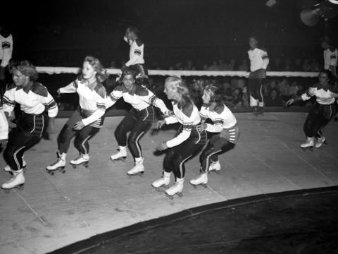 A group of woman speed on a banked track during an undated roller derby in Chicago.