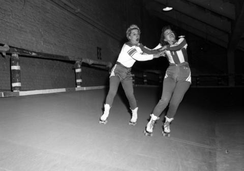 Toughie Brasuhn, left, and Betty Clements at a roller derby at the Coliseum in 1953.