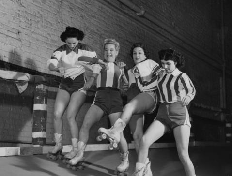 """Anne Pernice, left, Midge """"Toughie"""" Brashun, Mary Lou Palermo and Jean Porter get tangled up during a match at the Chicago Coliseum in Dec. 1953. Pernice and Palermo starred for the Chicago Westerners."""