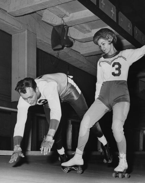 A 20-year veteran of Chicago roller derby teams, Mary Lou Palermo trips teammate Bob Venter in a skills demonstration at a training school in Chicago in 1964.