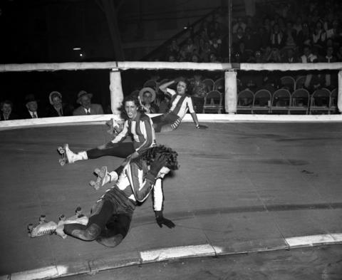"""""""Ya dumb jerks!"""" yells Mary Lou Palermo, center, to the Jersey Jolters who caused a three-way spill at the Roller Derby at the Coliseum on Feb. 14, 1951. The Jersey Jolters beat the Chicago Westerners 22 to 21, but it took the easterners four overtime periods to score the victory in front of 2,703 fans. Palermo, who was from Chicago, started skating roller derby's when she was just 15 in 1944."""