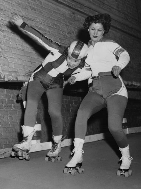 """Harriette """"Babe"""" Topel, left, tries to stay on her feet as she gets blocked by Mary Lou Palermo in Nov. 1953 at the Coliseum."""