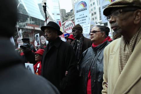 The Rev. Jesse Jackson, left, Chicago Teachers Union President Karen Lewis, center, and Rep. Bobby Rush, right foreground, lead a march and protest of planned school closings in March 2013.