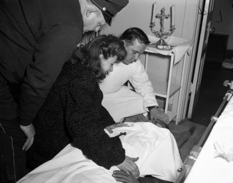 Estelle Cantoumanos identifies the body of her brother, John Kuesis, 33, who was murdered on Dec. 12, 1947. Kuesis was killed by Thomas Daley, 42, James Morelli, 20, and Lowell Fentress, 19, for allegedly snitching on them to the cops about an previous robbery.