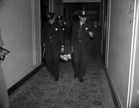Police remove Morton Stein's body from a room at the Stevens Hotel on May 11, 1945. Stein, 16, was murdered by his partner in crime, Donald Jay Cook, 15. According to Cook, the boys had been committing robberies together, but when Cook said he wanted out, a fight ensued. Cook bludgeoned Stein with a blackjack, stabbed him several times, and then stuffed him in the closet of their hotel room. Cook then fled to Lousiana, where he was arrested in September and sent back to Chicago to stand trial. Cook was sentenced to between 7 and 14 years in prison after he changed his plea from not guilty to guilty of manslaughter.