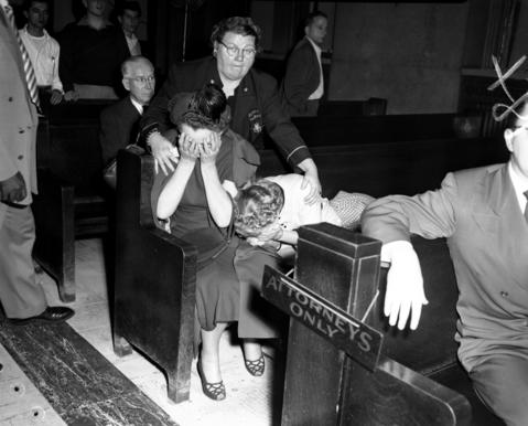 """Deputy Sheriff Jessie Tamillo, back center, comforts Susan Lettrich, second from right, and her friend after Lettrich's estranged husband George Lettrich Jr. was convicted of murdering Roberta Rinearson and sentenced to the electric chair on Oct. 18, 1951. Two years later, in 1953, the Supreme Court voided the death sentence, saying Lettrich's confession was """"taken by police after he was held incommunicado for 60 hours,"""" the Tribune reported. Furthermore, the court stated there was """"not a scintilla of evidence"""" to connect Lettrich with the crime."""