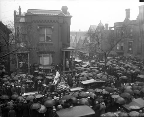 """A large crowd gathers outside the funeral for Joseph """"Diamond Joe"""" Esposito, the beloved Republican boss of the 19th Ward, who was involved in bootlegging, extortion, prostitution and labor racketeering. He was was shot 58 times from two double-barreled shotguns and a revolver in 1928."""