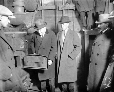 The greenhouse furnace where, in 1924, lawyer and horticulturist Warren J. Lincoln, third from left, burned the headless bodies of his wife, Lina Lincoln, and her brother, Byron Shoup, in Aurora, Ill. Lincoln murdered them on Jan. 10, 1923, and then cleverly faked his own death to make it seem as though they had murdered him and fled.