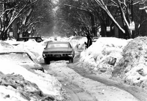 People were still digging out their cars on Jan. 29, 1979, and many side streets had not been plowed, like this one at Erie and Paulina Streets in Chicago.
