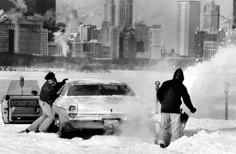 A motorist is stuck in a snow drift as a good samaritan comes to his rescue with a snow blower on January 2, 1979. In ten days the city of Chicago would get more than 20 inches of snow during the blizzard of 1979.