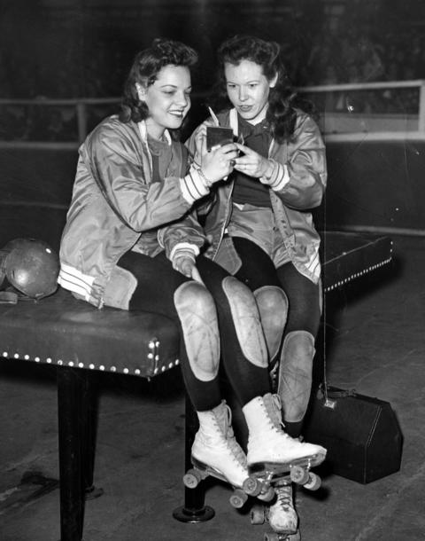 Katy King, left, and Gerry Murray, both of the Chicago team, apply make-up before skating into the roller derby ring on Oct. 22, 1946. Murray is in the Roller Derby Hall of Fame.