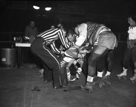 Referees and skaters try to pry loose Mary Lou Palermo of the Jersey team from the grip she has on the hair of Betty Boyd of the Chicago Westerners in a roller derby at the Coliseum in 1951. Palermo, who was from Chicago, started skating roller derby's when she was just 15 in 1944.