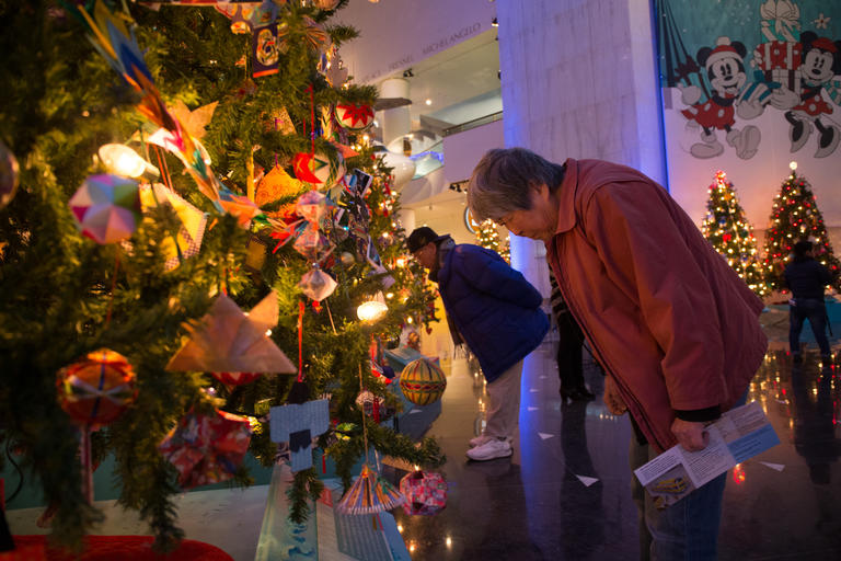 jack and jun dairiki check christmas tree with japanese decorations at the museum of science and - Christmas Around The World Chicago