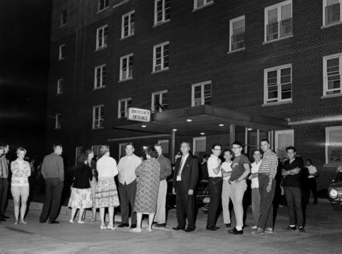 A crowd gathers outside the Ingalls Memorial Hospital in Harvey, Ill., where many of the injured were taken during the rioting in Dixmoor, Ill., on Aug. 16, 1964.