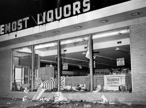 Foremost Liquors, at 2240 W. 147th St., shows the effects of two days of rioting, which started on Aug. 16, 1964. The trouble began after demonstrators picketed the store protesting the arrest of a woman on Saturday night on charges she tried to steal a bottle of liquor.