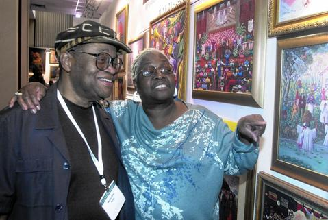 "Chicago-raised artist Annie Lee, right, was best known for her painting ""Blue Monday."" She is seen here with Chicago artist Melvin King. Lee died Nov. 24 in the Las Vegas area at 79."