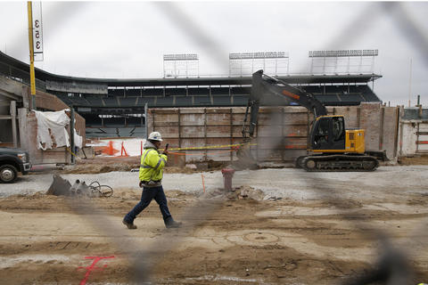 Workers work on the infrastructure on North Sheffield Avenue outside of the right field bleacher renovations at Wrigley Field in Chicago.