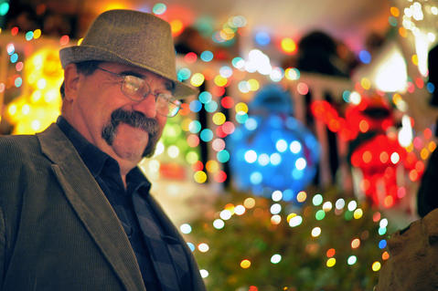 The man who is credited with starting the Miracle on 34th Street, Bob Hosier, smiles during the annual 34th Street Christmas lighting ceremony on Saturday.
