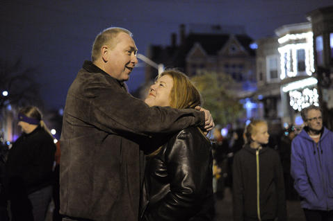 Johnn Simmens of Columbia snuggles with Jamie Robinson of Woodstock as they wait for the big moment during the annual 34th Street Christmas lighting ceremony Saturday.