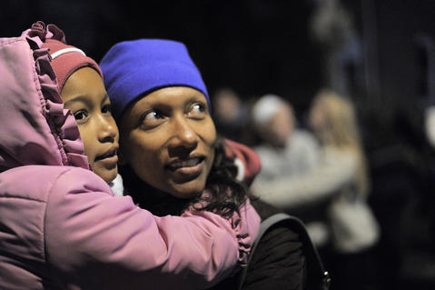 Ana DePina holds her daughter Amani Norman, 6, of Baltimore as they wait for the big moment during the annual 34th Street Christmas lighting ceremony Saturday.
