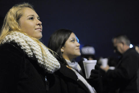 Lexie Mealey of Ocean City, N.J., (left) and Oskana Gomez of Elkton wait for the big moment during the annual 34th Street Christmas lighting ceremony Saturday.