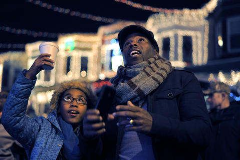 Saleem Heggins of Randallstown and his 12-year-old sister Hope Heggins are amazed at the displays during the annual 34th Street Christmas lighting ceremony Saturday.