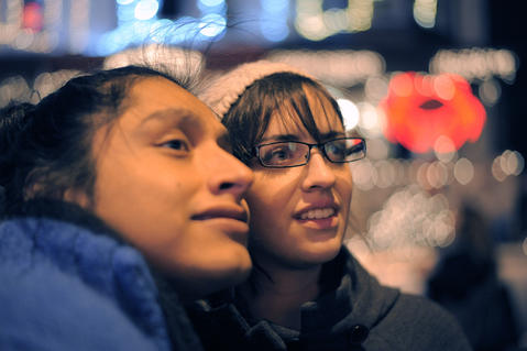 Rudy Lee (left) and Lauren Rosales, both of Baltimore, look at the lights at the annual 34th Street Christmas lighting ceremony Saturday.