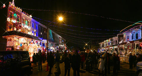 Houses are lit up during the annual 34th Street Christmas lighting ceremony Saturday.